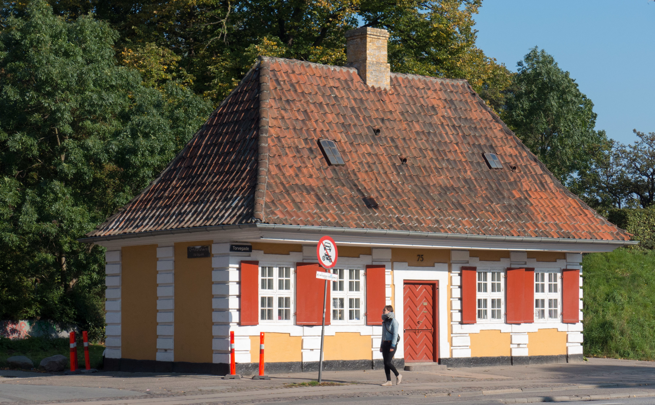 On the east side of Torvegade, just inside the south embankment, is the Customs House built in 1724 on the city side of Amagerport.