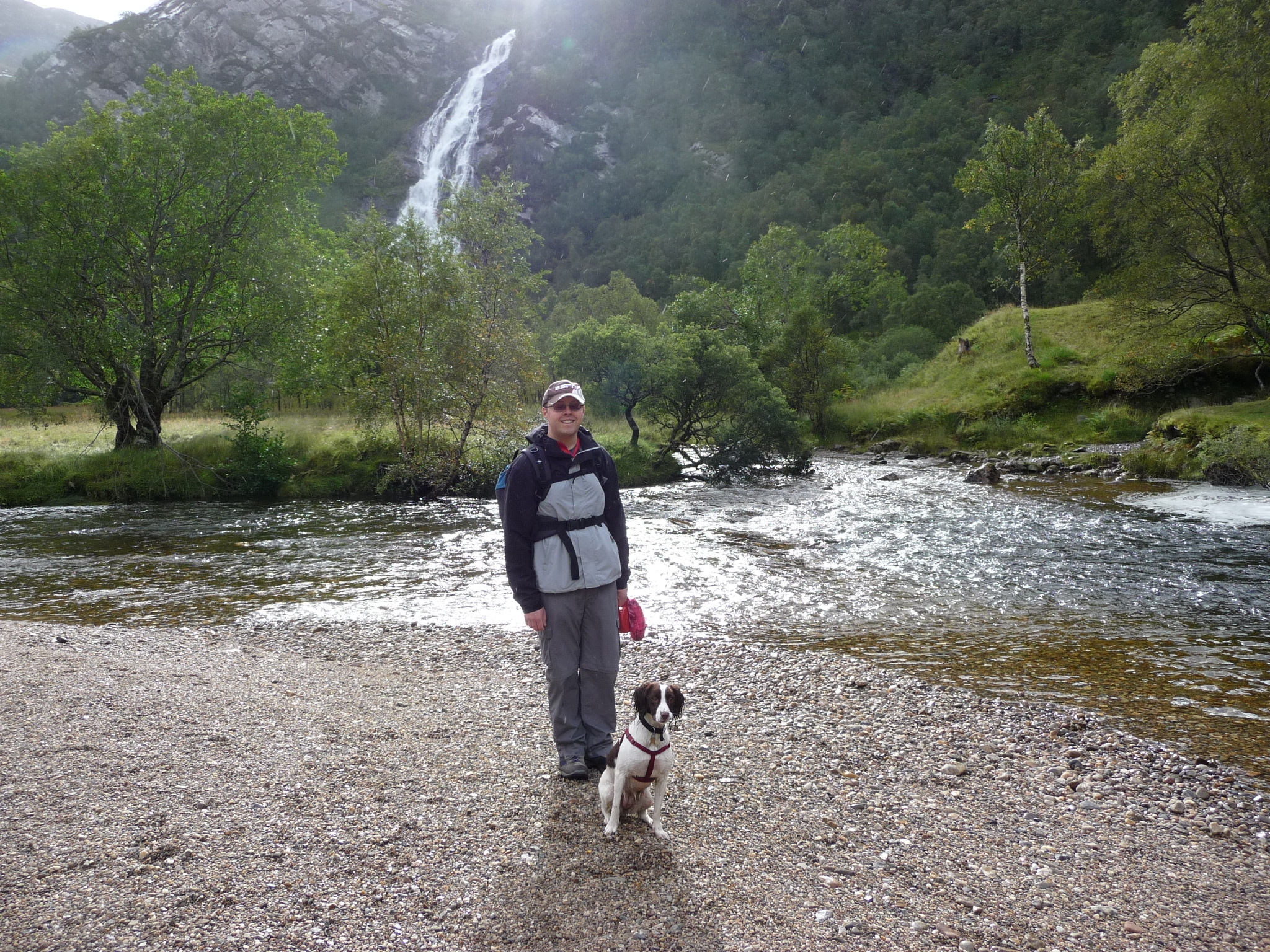 Paul Forrester - the Writing Man - and his springer spaniel Chloe at the third highest waterfall in Scotland, at Glen Nevis