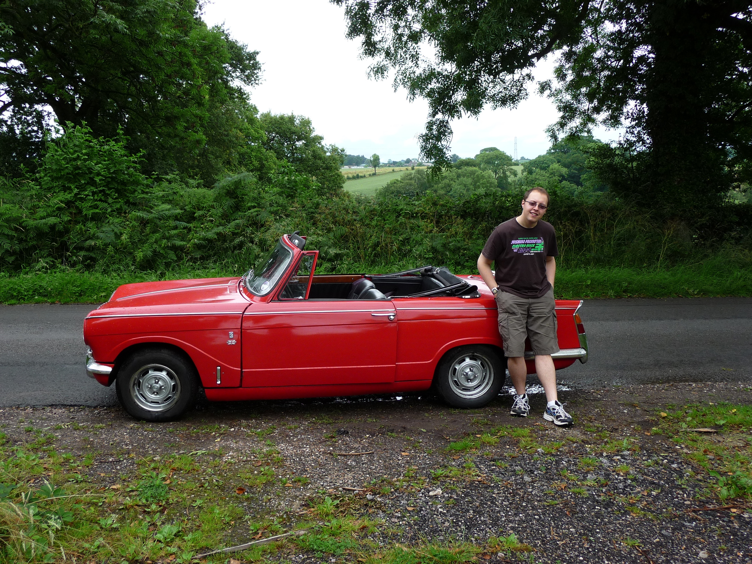 The Writing Man with his top on, and the Triumph Vitesse with its top down