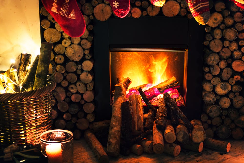 Stock photo of a log fire that may or may not be in a country pub.