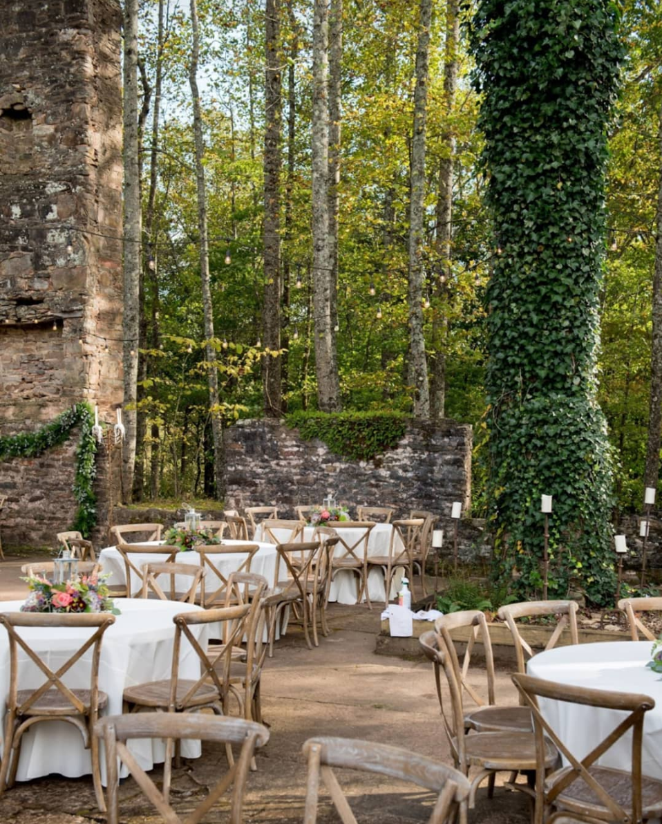 Enchanting Reception Space - Pristine historic facilities featuring the unique stone ruins with 40 ft chimney, band stage, and string lights.