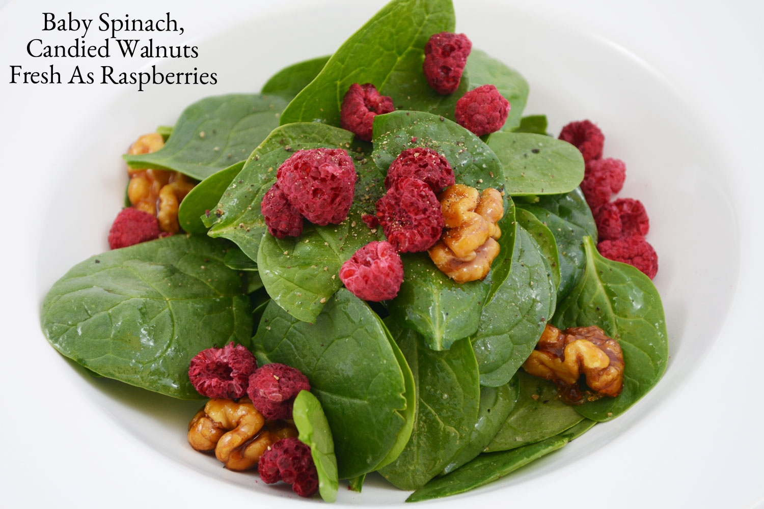 BAY-SPINACH-SALAD-TOSSED-WITH-WALNUT-OIL,-FRESH-AS-RASPBERRIES-AND-CANDIED-WALNUTS.jpg