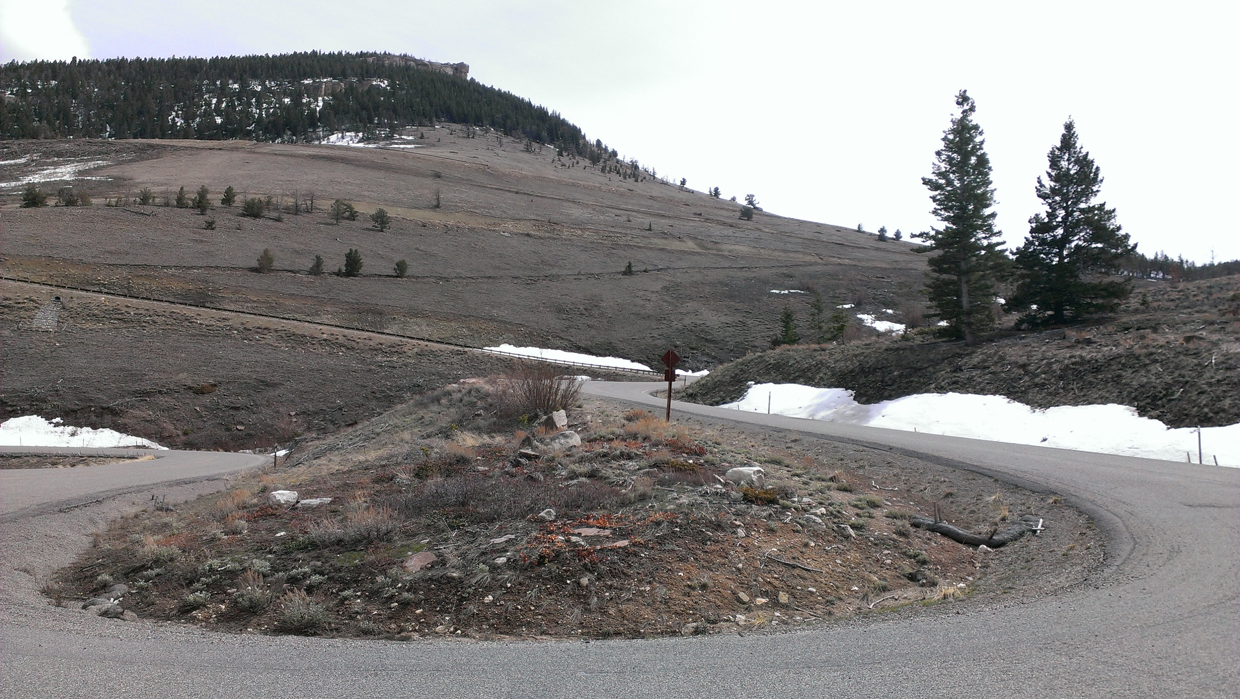 Mid-height hairpin with with switchbacks looming above.