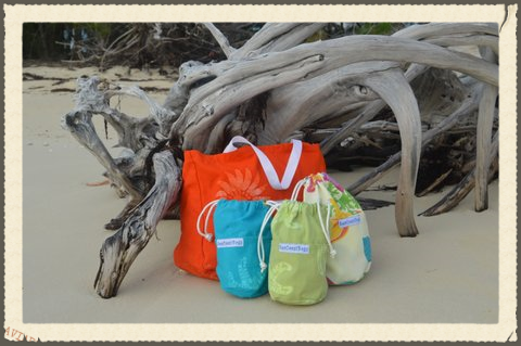 "Sea Coast Bags are a custom sewn canvas ""ditty bag"" for whatever you are carrying to the beach, the pool, the golf course or your favorite spot. SCBs were inspired by life in the Bahamas and living aboard a boat where things get misplaced all the time. These bags provide great storage are are available in three sizes and in many different fabrics. All our bags are made in the USA out of custom dyed Androsia Batik fabric and speciality featured fabrics."