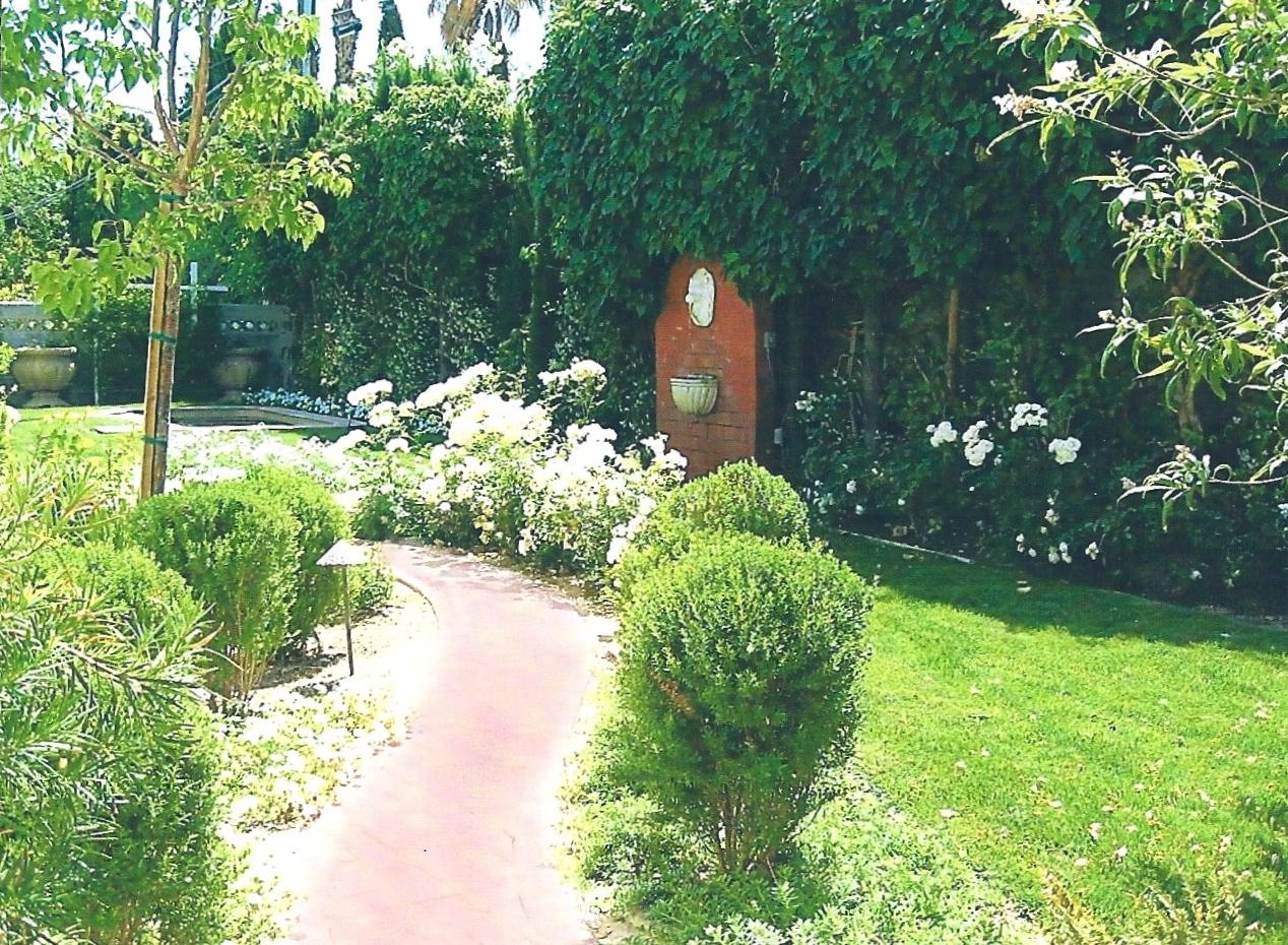 Brick pathway winds through garden
