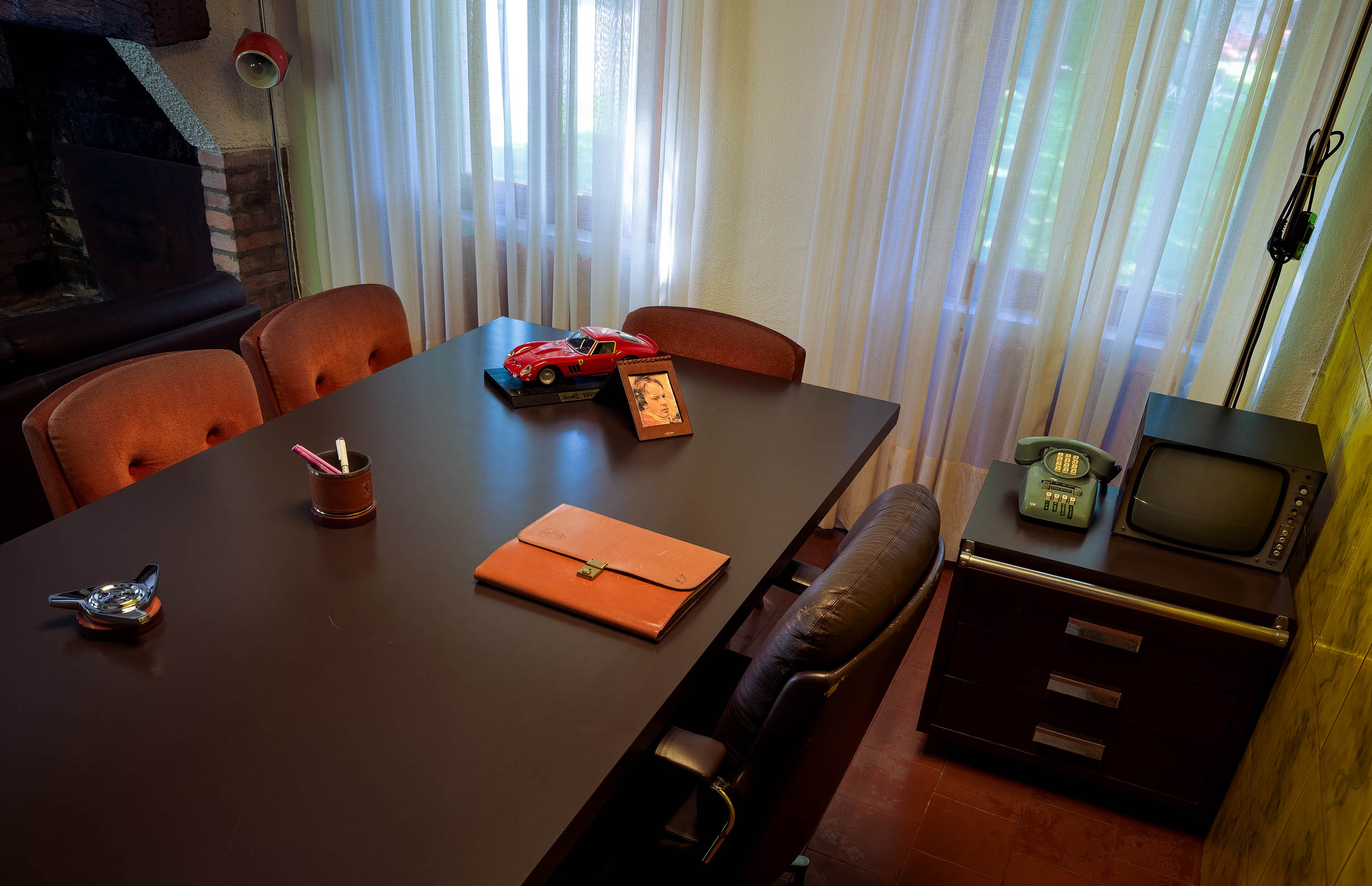 Enzo Ferrari's Desk with a Model 250GTO and a Picture of Gilles Villeneuve