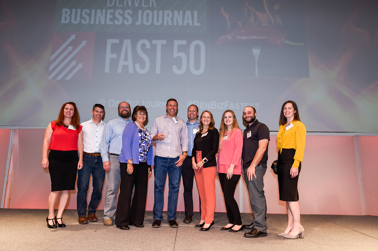The CORE team accepts the award for the 6th fastest-growing Denver-area private company (Medium) at the  Denver Business Journal's  Fast 50 Reception. From left to right: Jennifer Kraus, Tom Girard, Andy Reynolds, Elna Smith, Dave Forbes, Rob Hansen, Wendy Clasen, Lauren Kirschbaum, Asa Miller, Tina Brazil.  Photo courtesy  Denver Business Journal