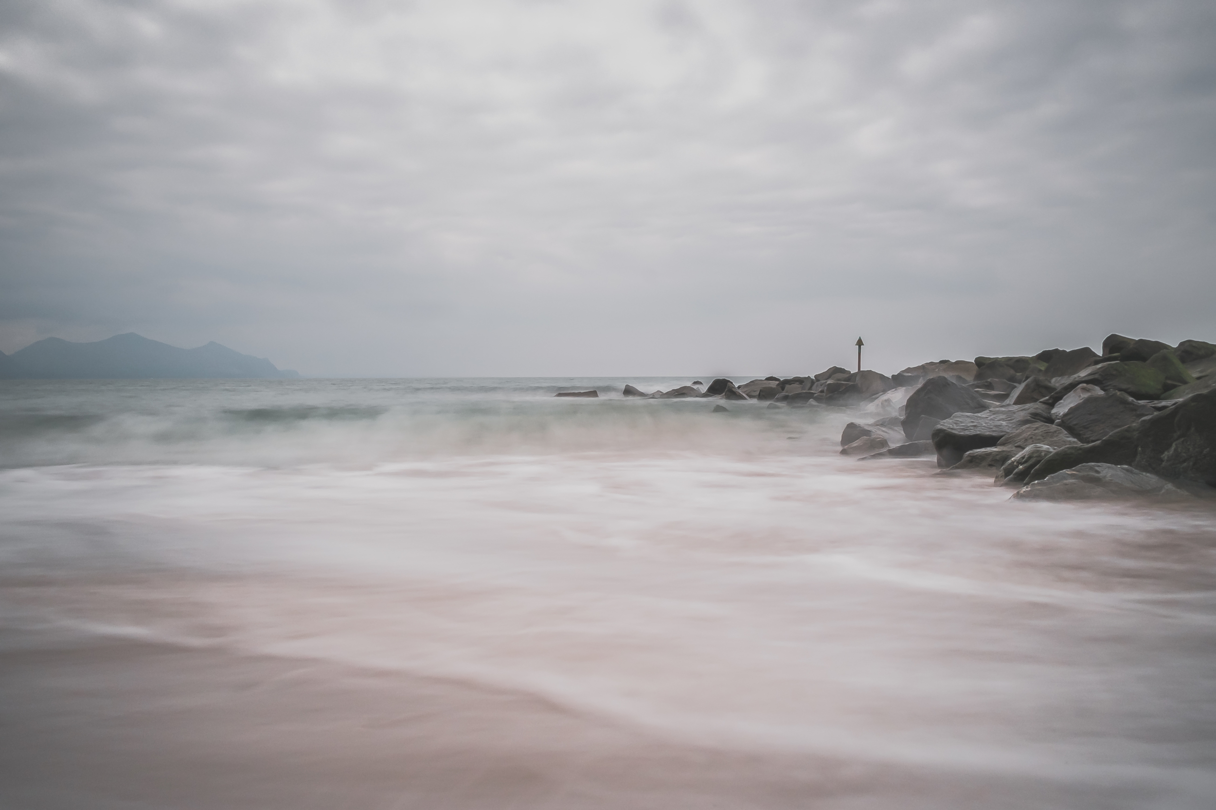 Dinas Dinlle - X-Pro1 + 18mm f/2 & B+W 110 ND Filter @ f/16. ISO200. 3.2 second exposure.