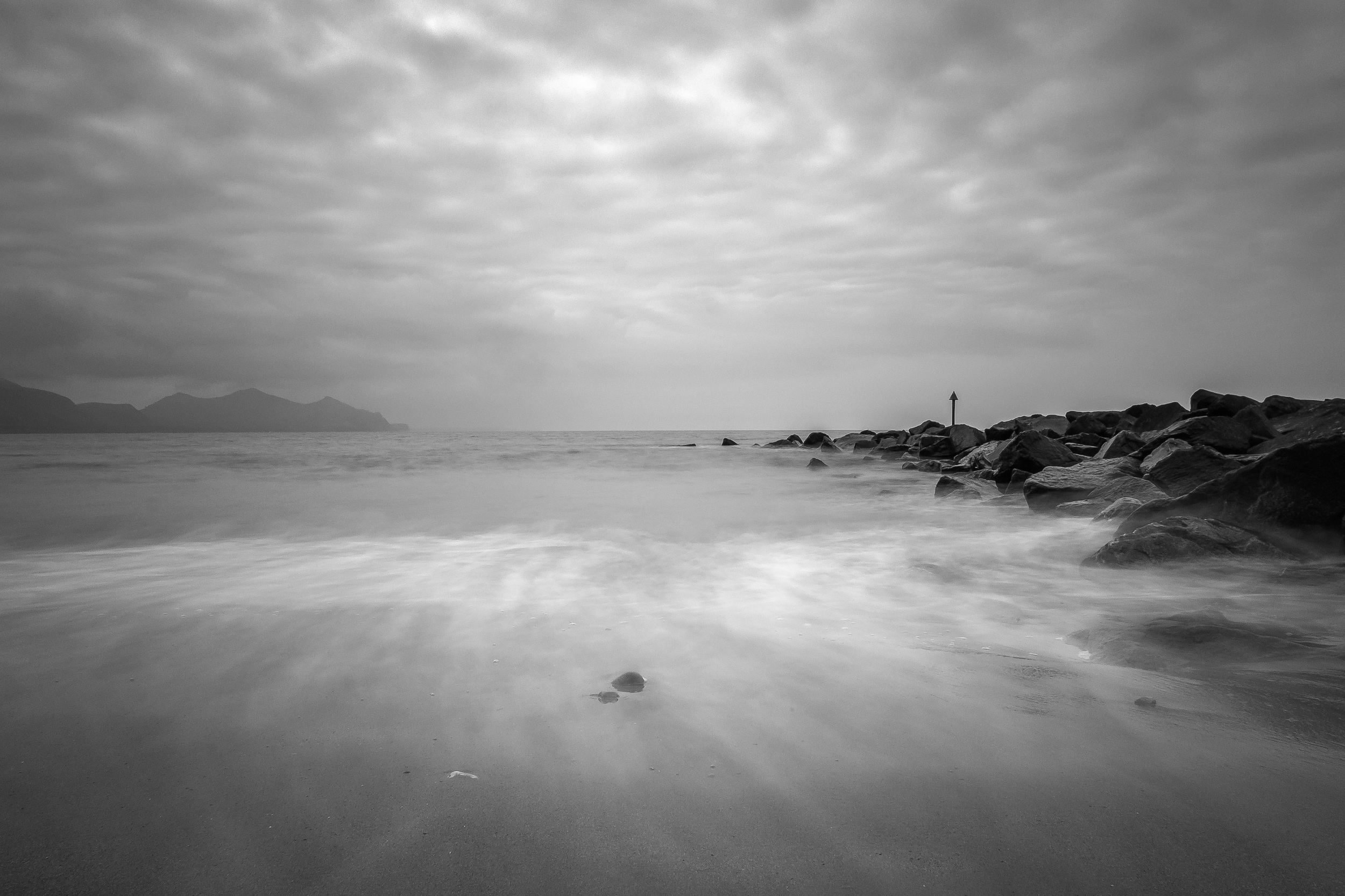 Dinas Dinelle - X-Pro1 + 18mm f/2 & B+W 110 ND Filter @ f/16. ISO200. 3.5 second exposure. Converted into monochrome in Lightroom.