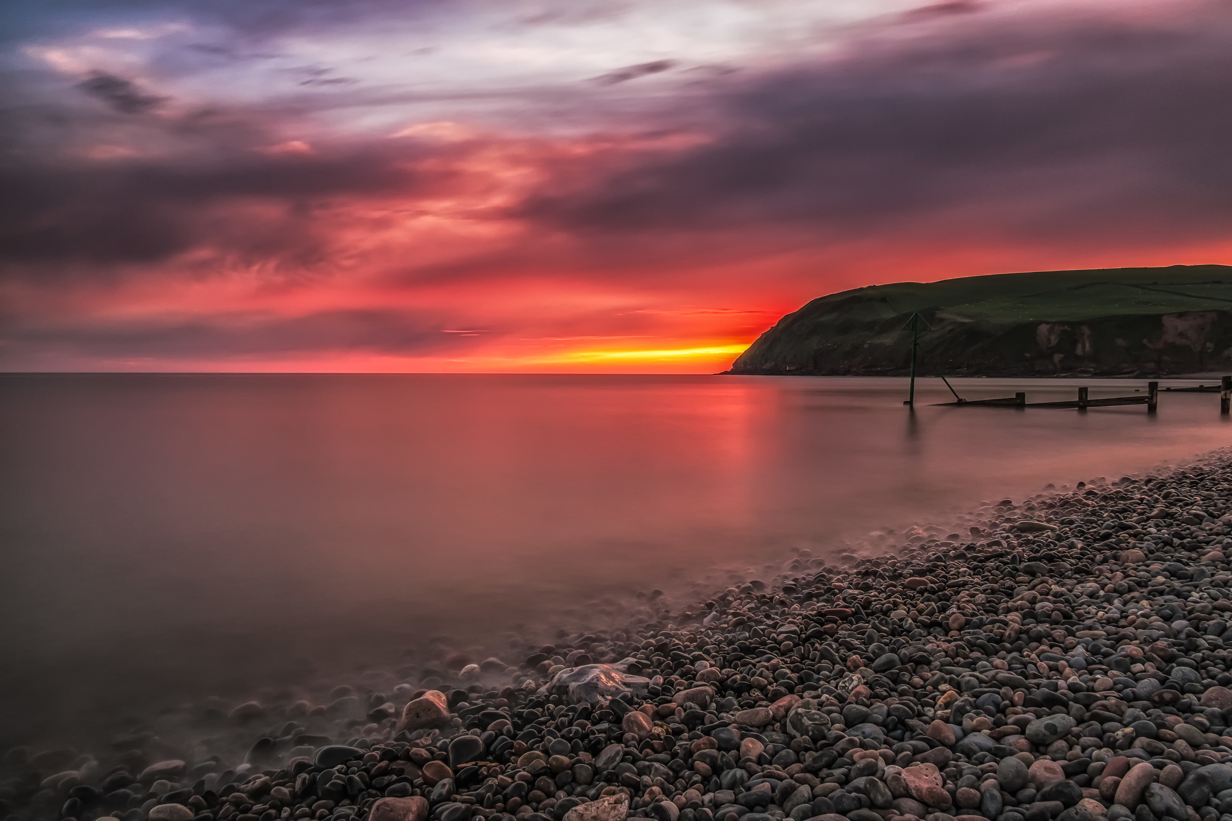 Sunset over St Bees on the Cumbrian coast.Fujifilm X-T1 + 18mm f/2 @ f/10. ISO250. B+W ND Filter. 28 Second Exposure.