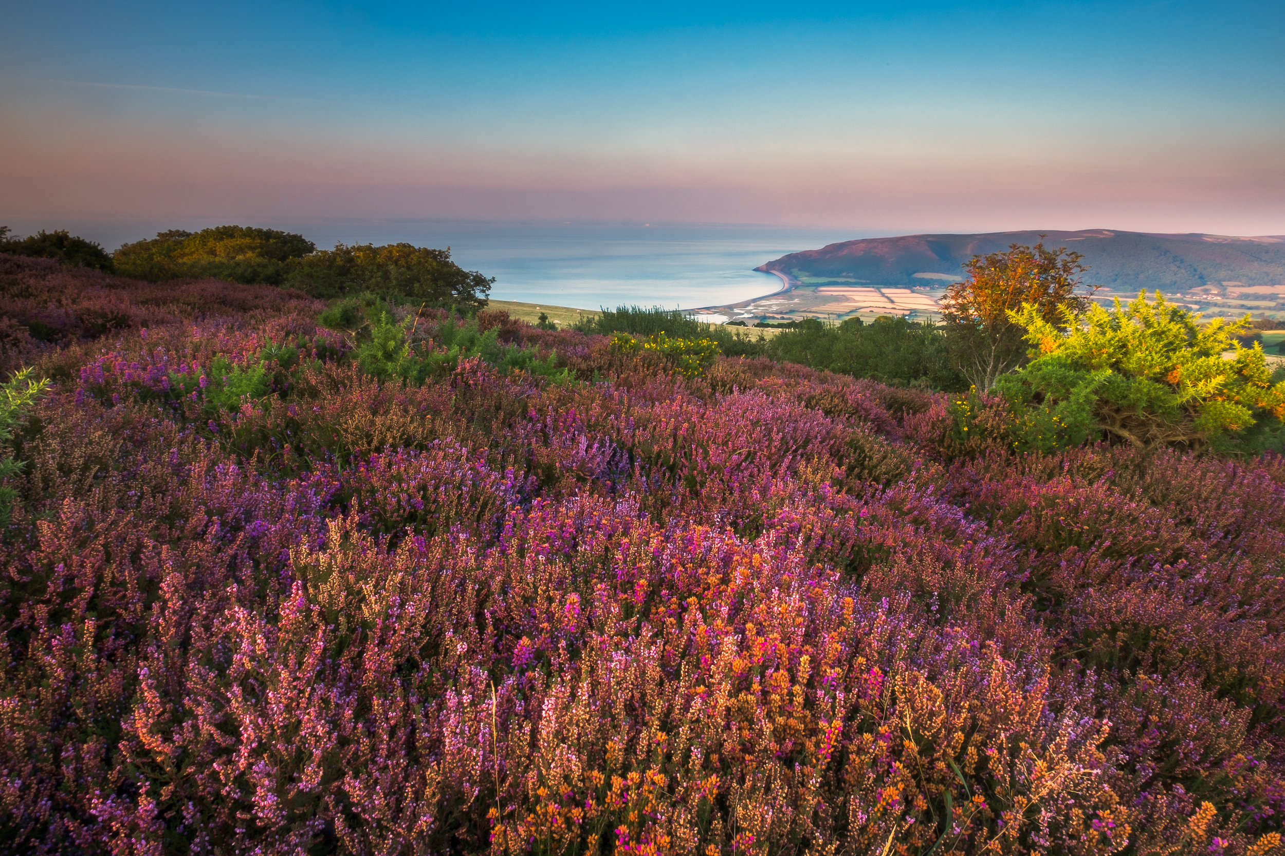 Sunset or Porlock Hill looking out towards the sea. Fujifilm X-T1 + 10-24mm @ f/22. 1/3.