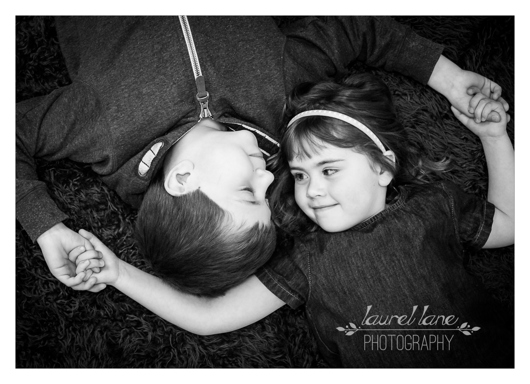 portrait by child photographer laurel lane photography in macclesfield holding hands.jpg