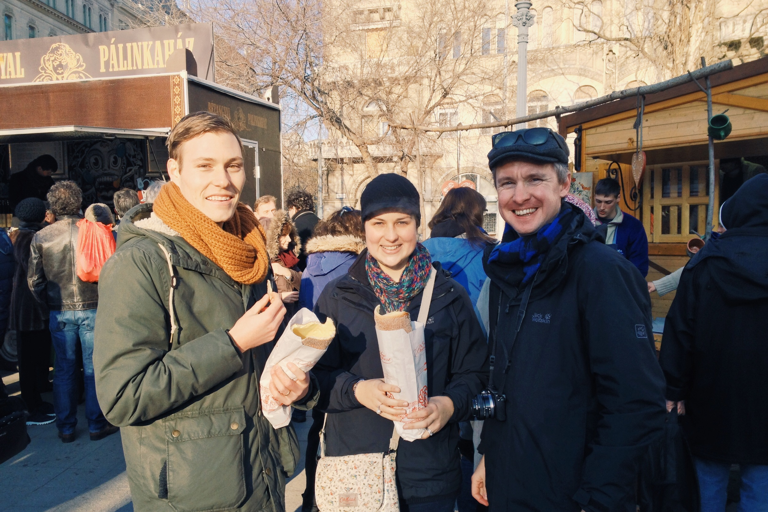 "Jacob, Zoe, and Neil eating a ridiculously addictive Hungarian pastry called....I have no idea. In German it is called ""Baumkuchen""."