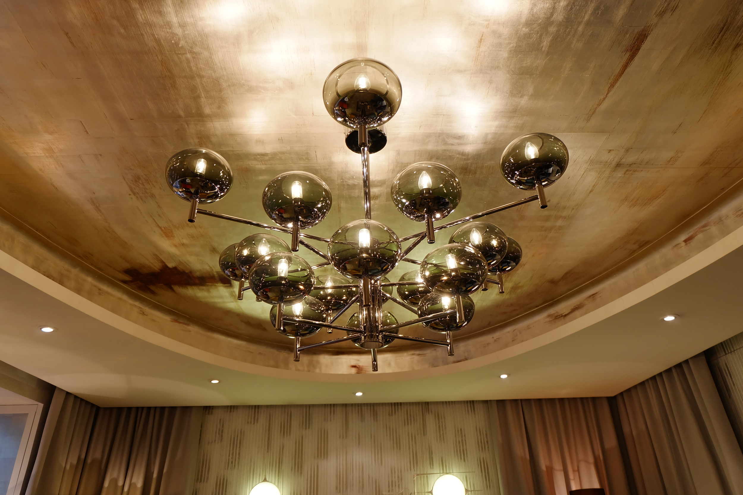 Maison & Objet 2016 Highlights - Gold leaf ceiling is a perfect background for contemporary lighting fixture in shiny metallics and glass | MSH Agency