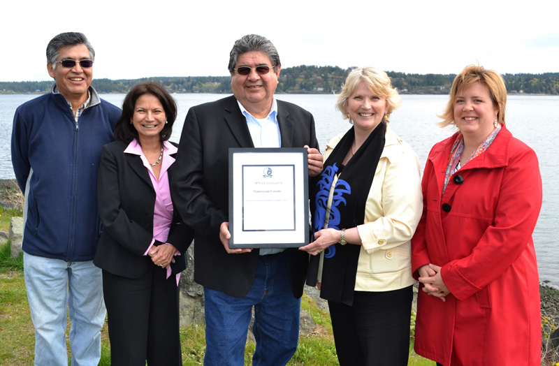 Mainstream Canada gathered on May 3rd, 2011 to celebrate Mainstream's APSA certification. From left:  Wally Samuel  - chair of the Ahousaht Fish Farm Committee,  Marguerite Parker  - program administrator for the Aboriginal Aquaculture Association (AAA),  Richard Harry  - AAA president,  Laurie Jensen  - Corporate Sustainability Manager for Mainstream Canada, and  Karin Maier  - First Nations Consultant Co-ordinator for Mainstream     Canada.