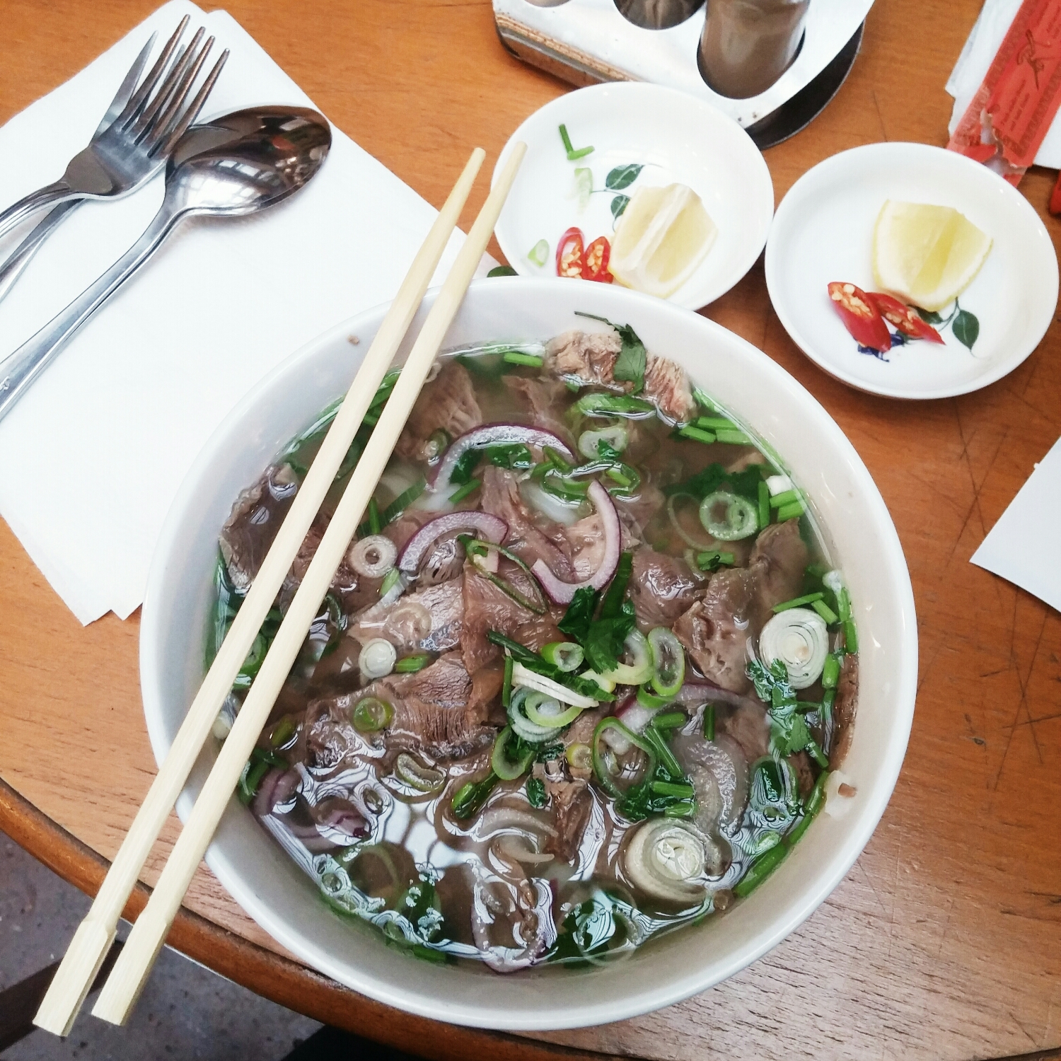 {What's a vacation without a bowl of pho? And a beer of course.}