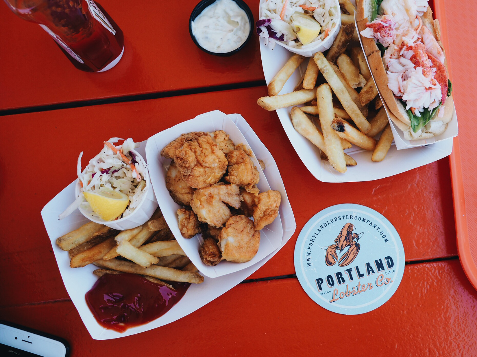{Fried scallops, fries, and a lobster roll.}