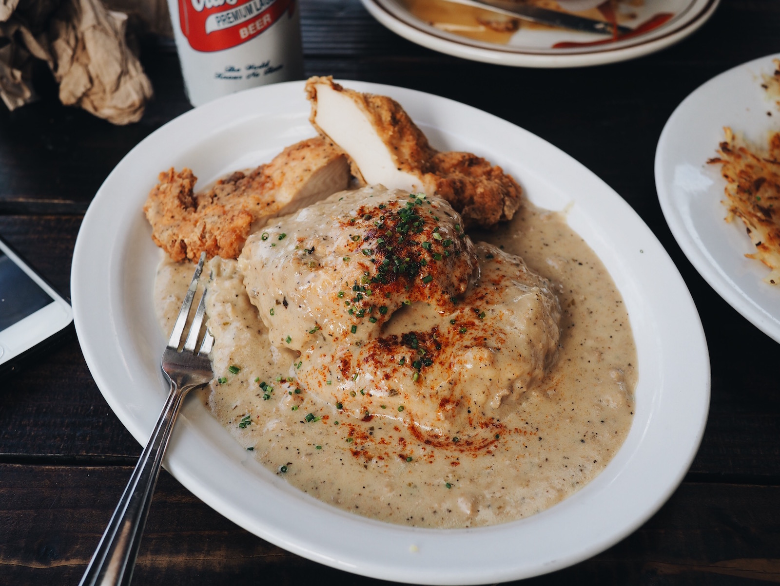 {Biscuits & gravy with fried chicken.}
