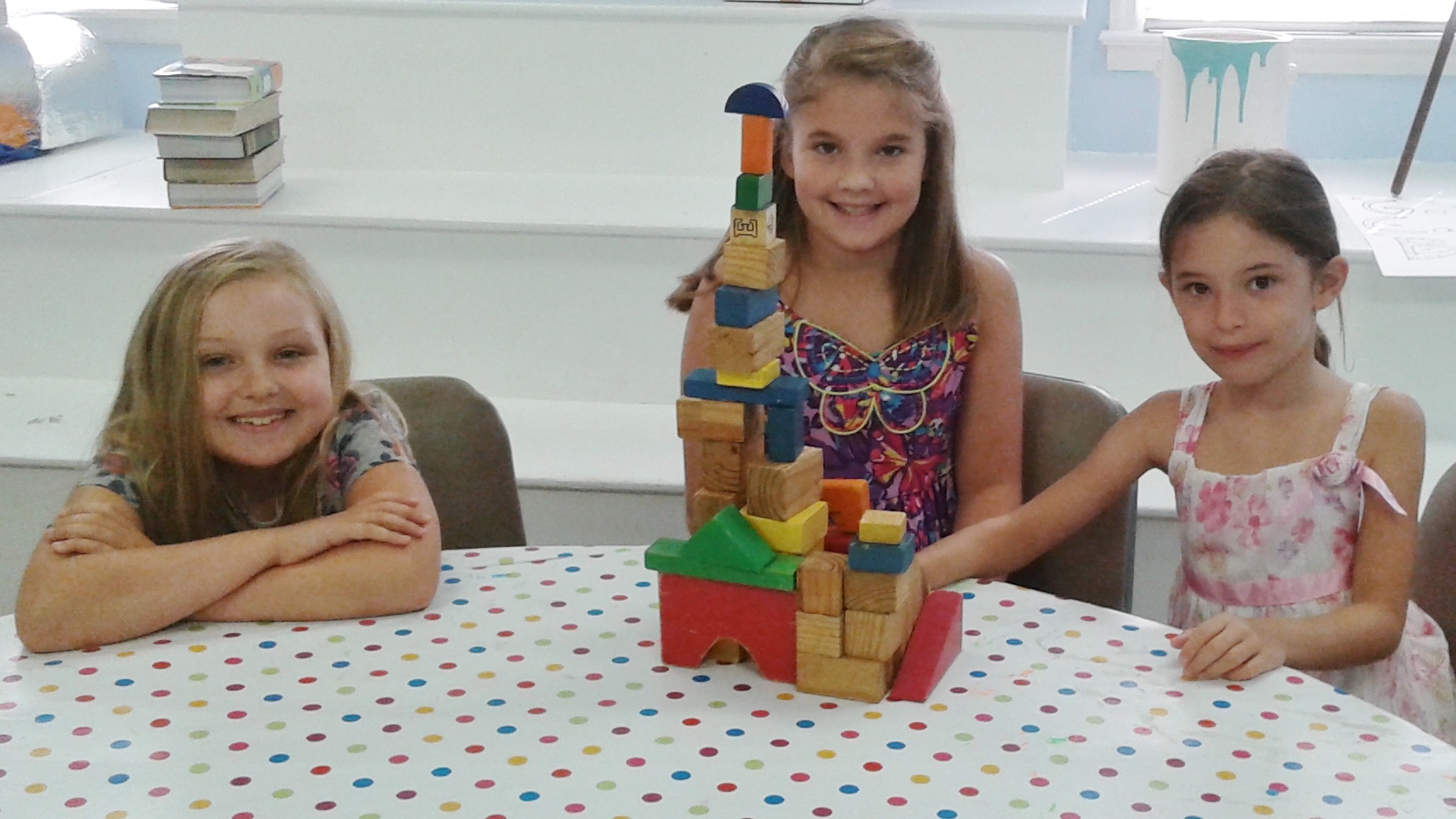 The girls have a beautiful tower.