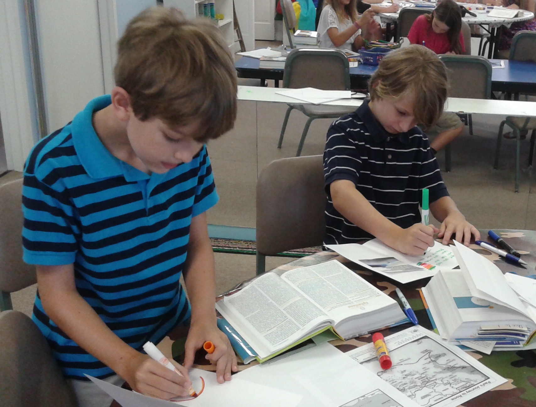 Gabe and John Anson use Scripture for their cards.