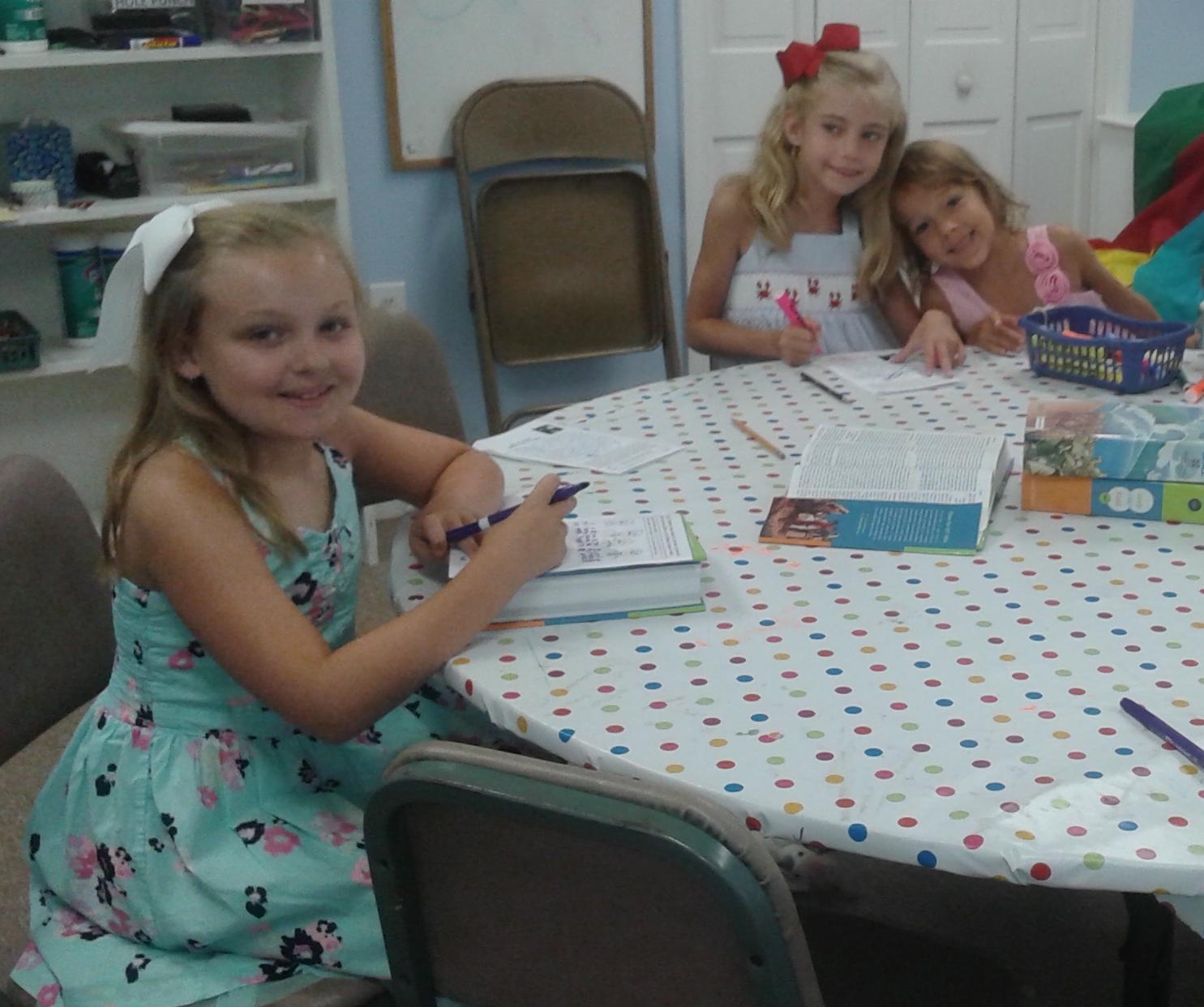 Girls reading Ephesians.
