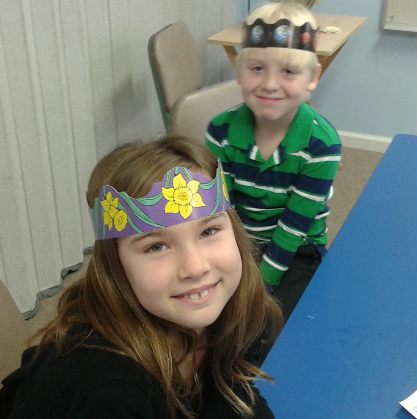Ava and William like their crowns.