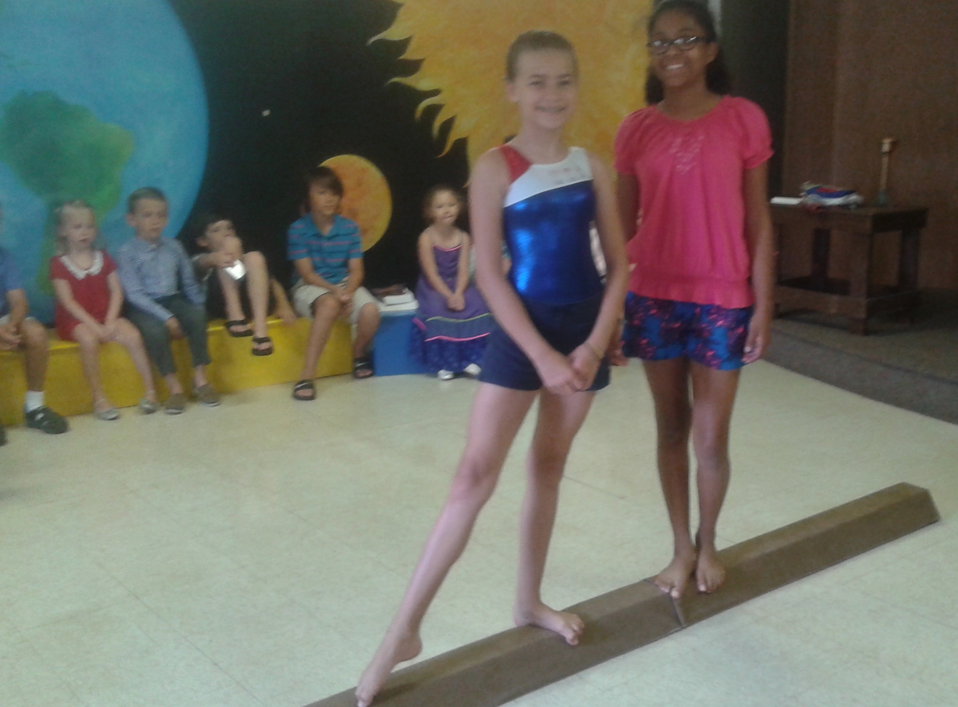Elena and Anna demonstrated the balance beam.