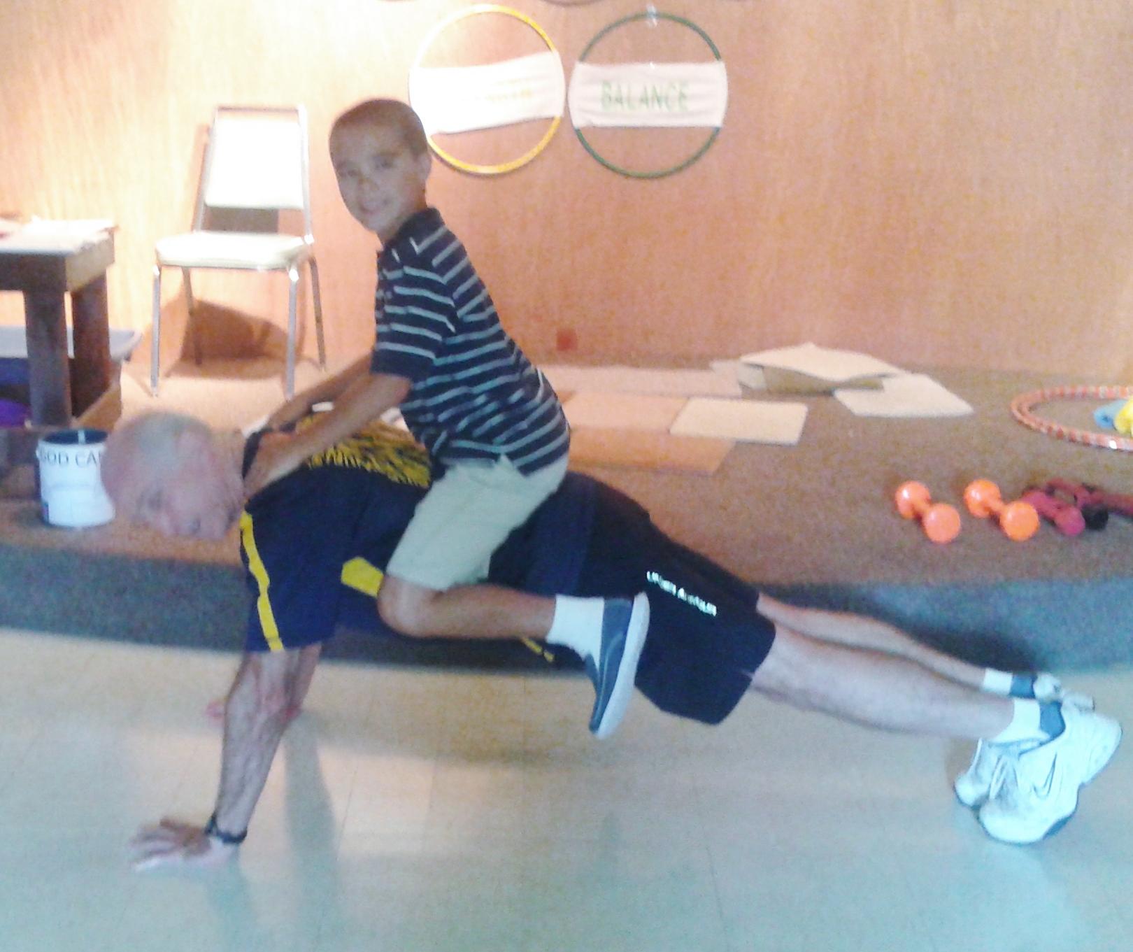 Adding weight to push ups.