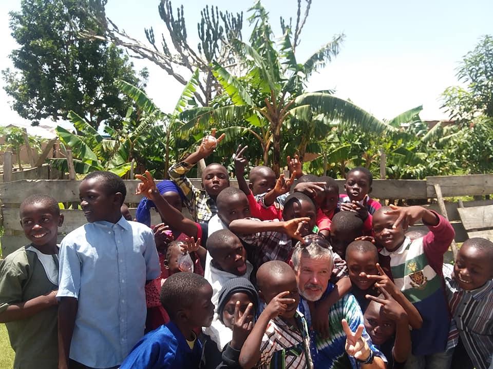 Kwashi kids loving on uncle Steve.jpg