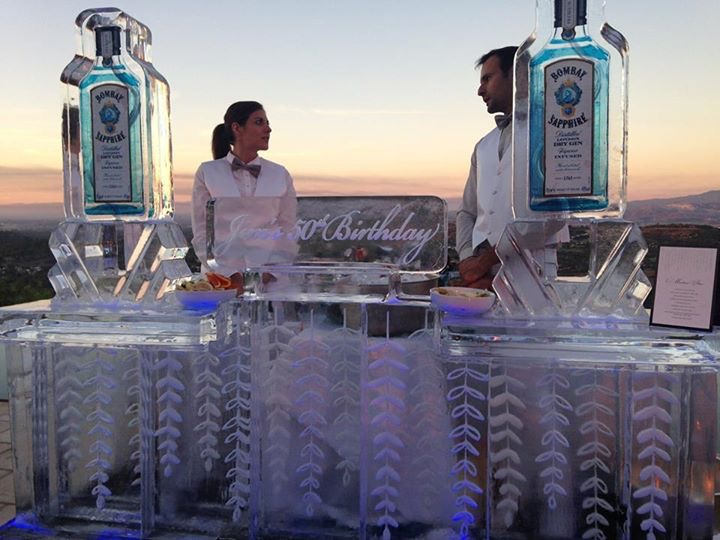 The custom ice sculpture bar using elements from the invitation was absolutely stunning.
