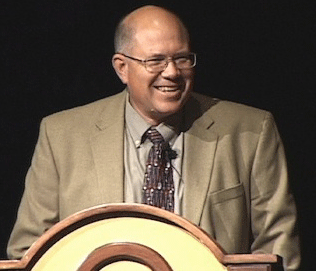Paul H. Smith speaking at a conference.