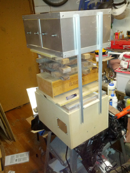 Aligning the vacuum form: the oven is positioned over the vacuum box at the proper height and aligned with the frame.