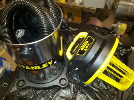The shop vac being disassembled.