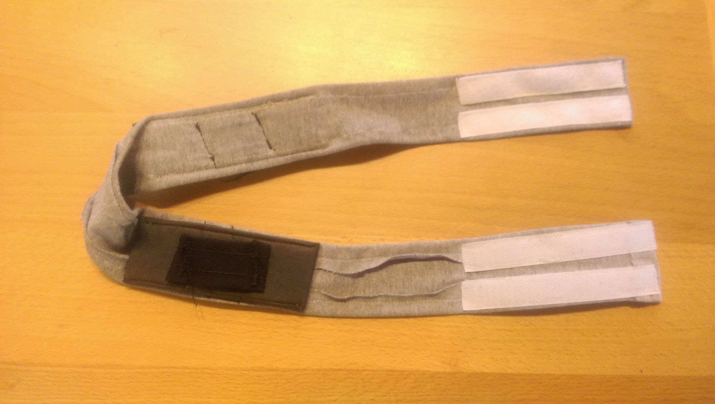 Finished headband showing the Velcro fasteners and the padded straps that wrap around the lever arms