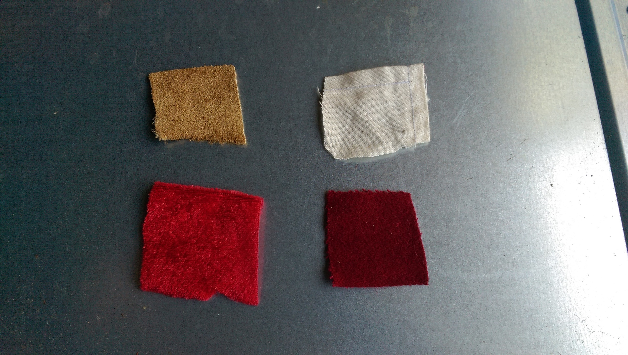 From upper left clockwise: leather, cotton linen, wool, red velvet