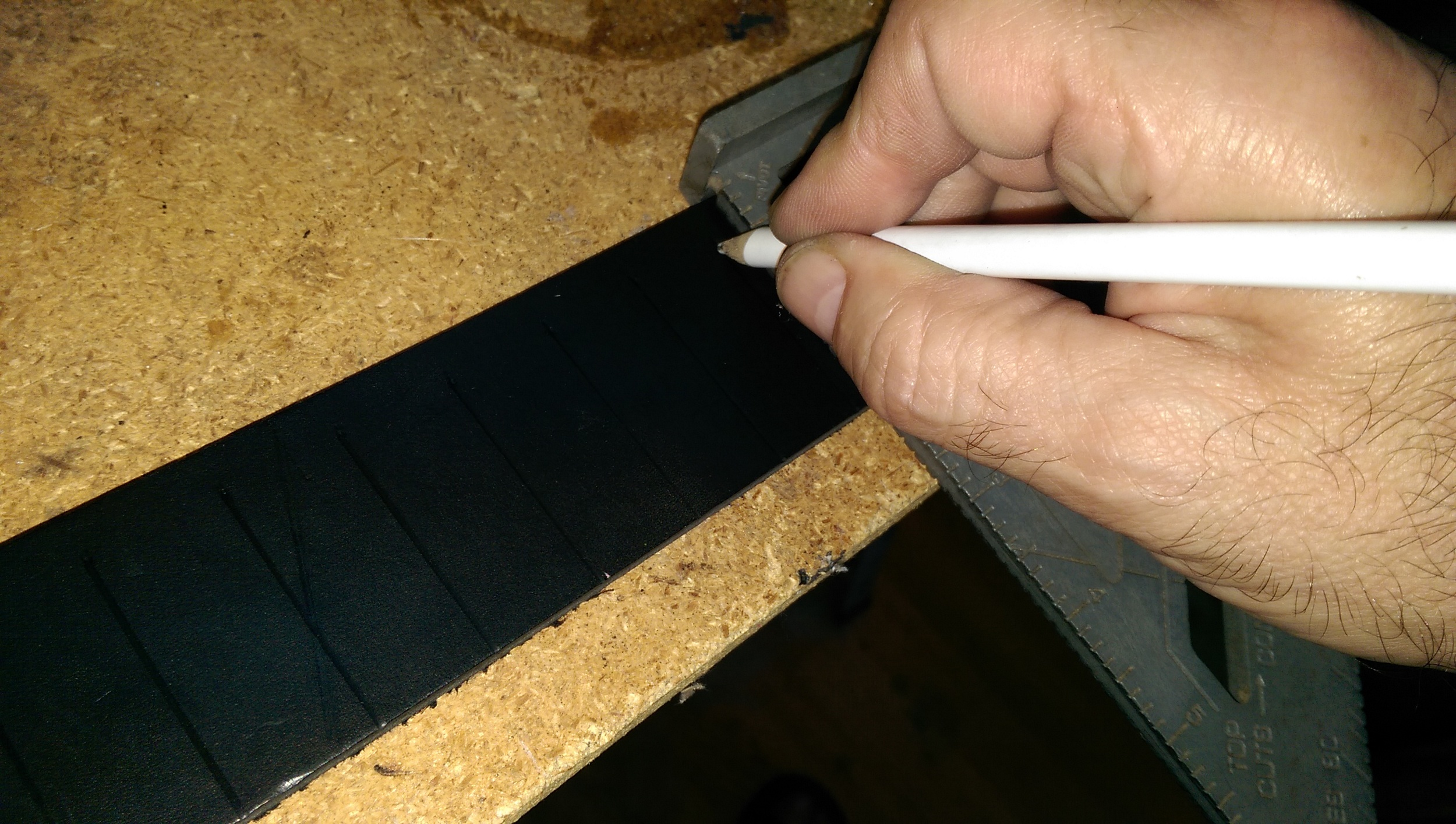 "Marking spacing along the 2"" base strap. Similar marks were placed along the soft leather strap."