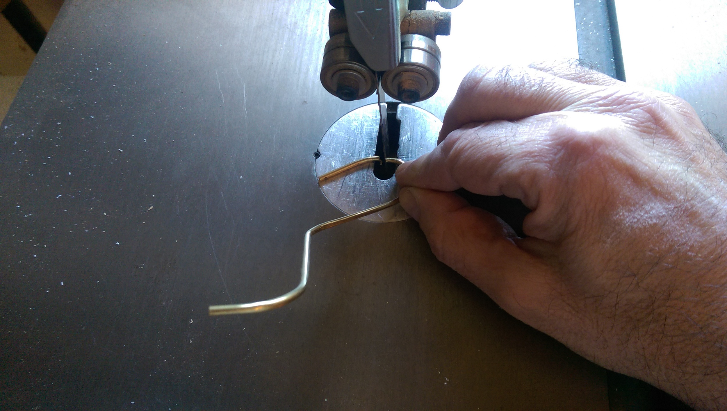 Cutting the brass tube with a bandsaw