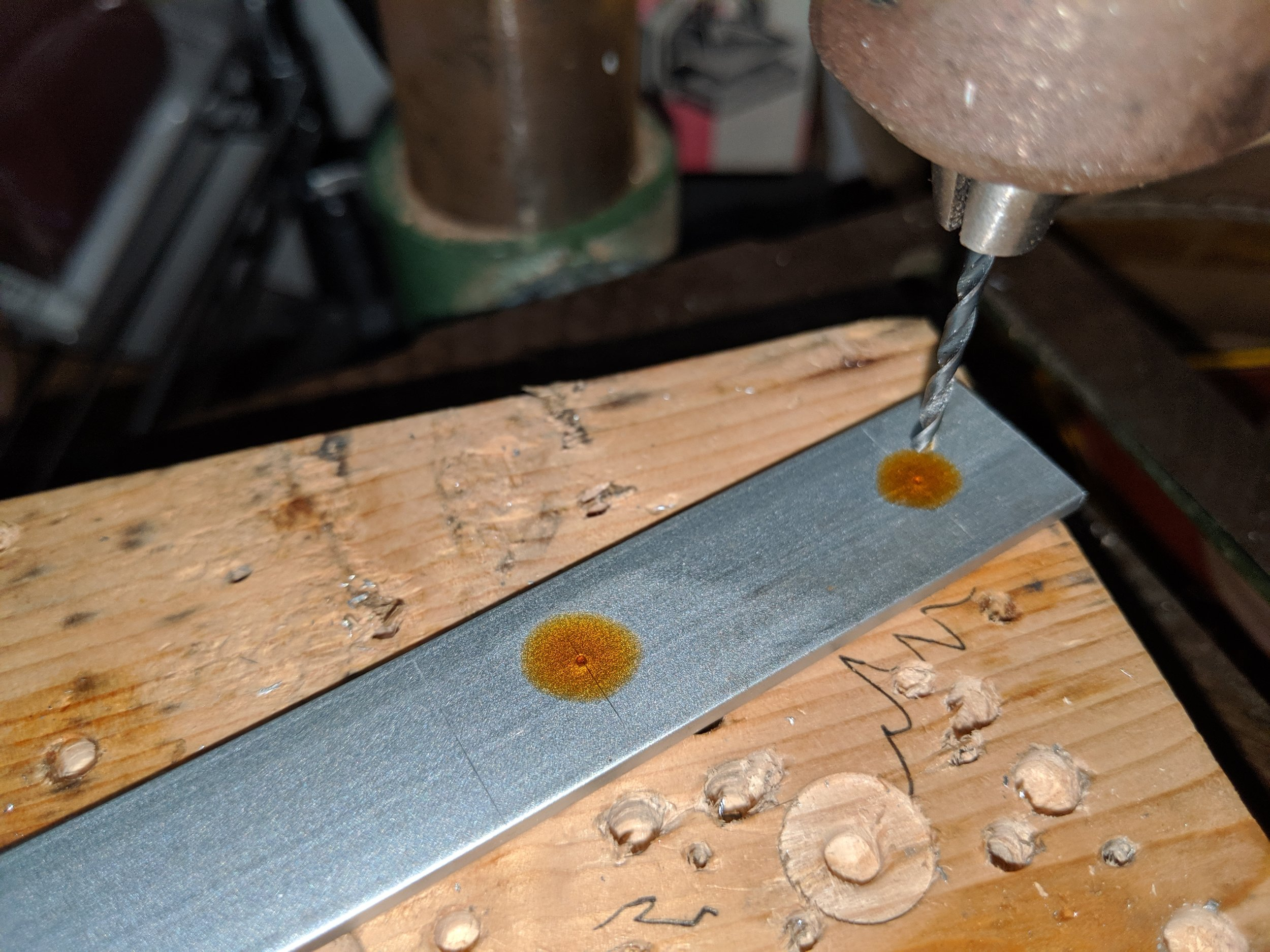 I prefer using cutting oil and making a pilot hole