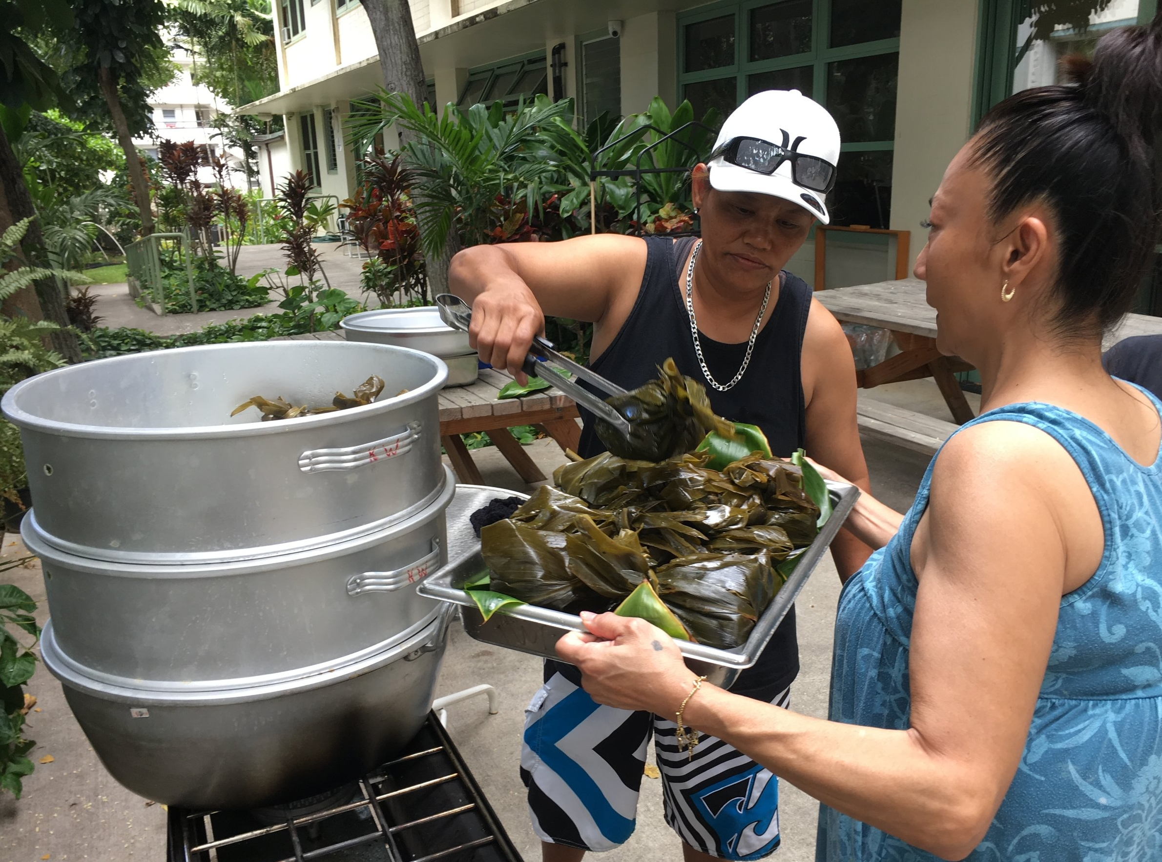 """Deborah & Happy removed lau lau from the steamer at the Hawaiian-themed """"Cooking With Friends"""" session at Fernhurst."""