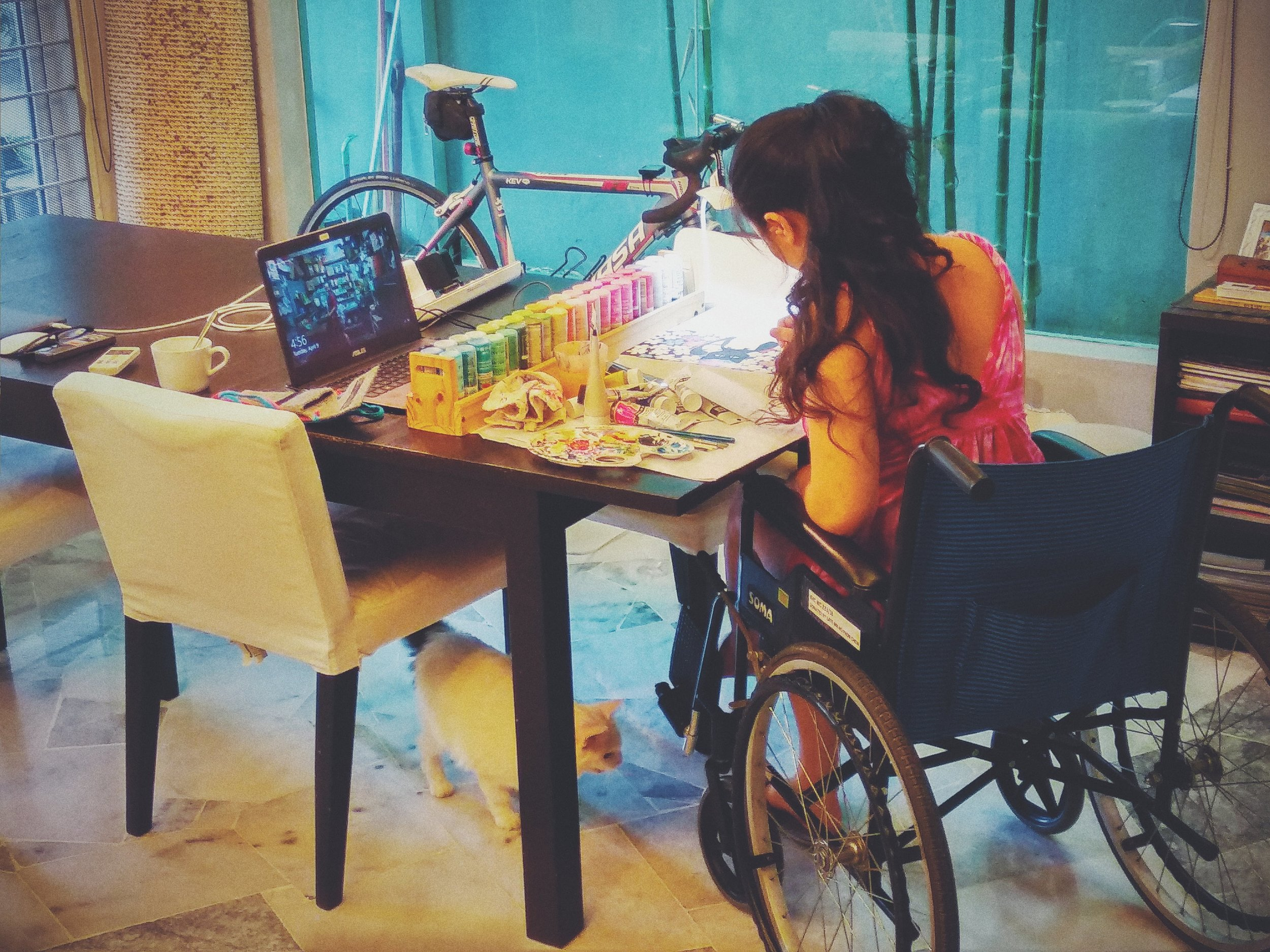 Me painting on wheelchair.jpg