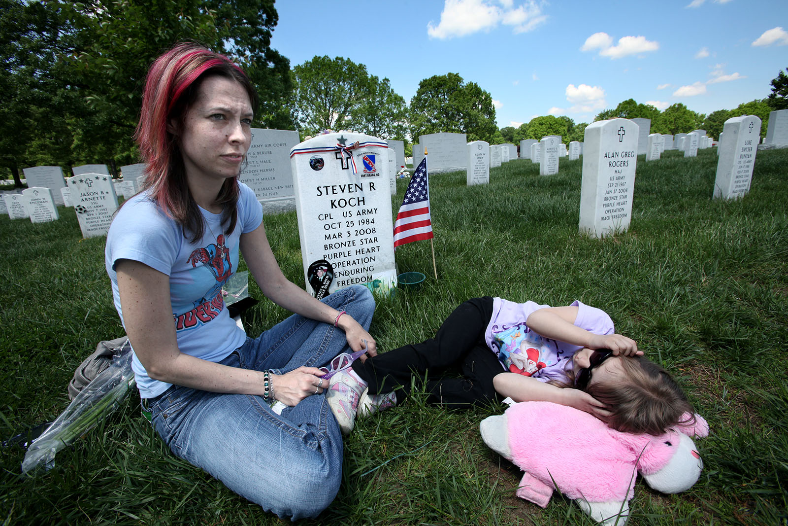 Amy is visiting her husband Steve's grave at Arlington National Cemetery. Their daughter Zoe is with her. He died in Afghanistan in 2008.