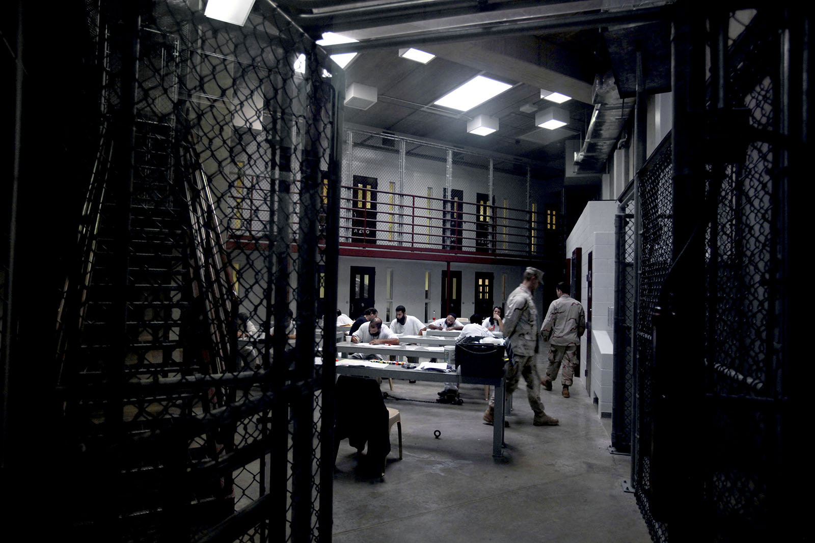 Prisoners at Guantanamo Bay are having a drawing class.