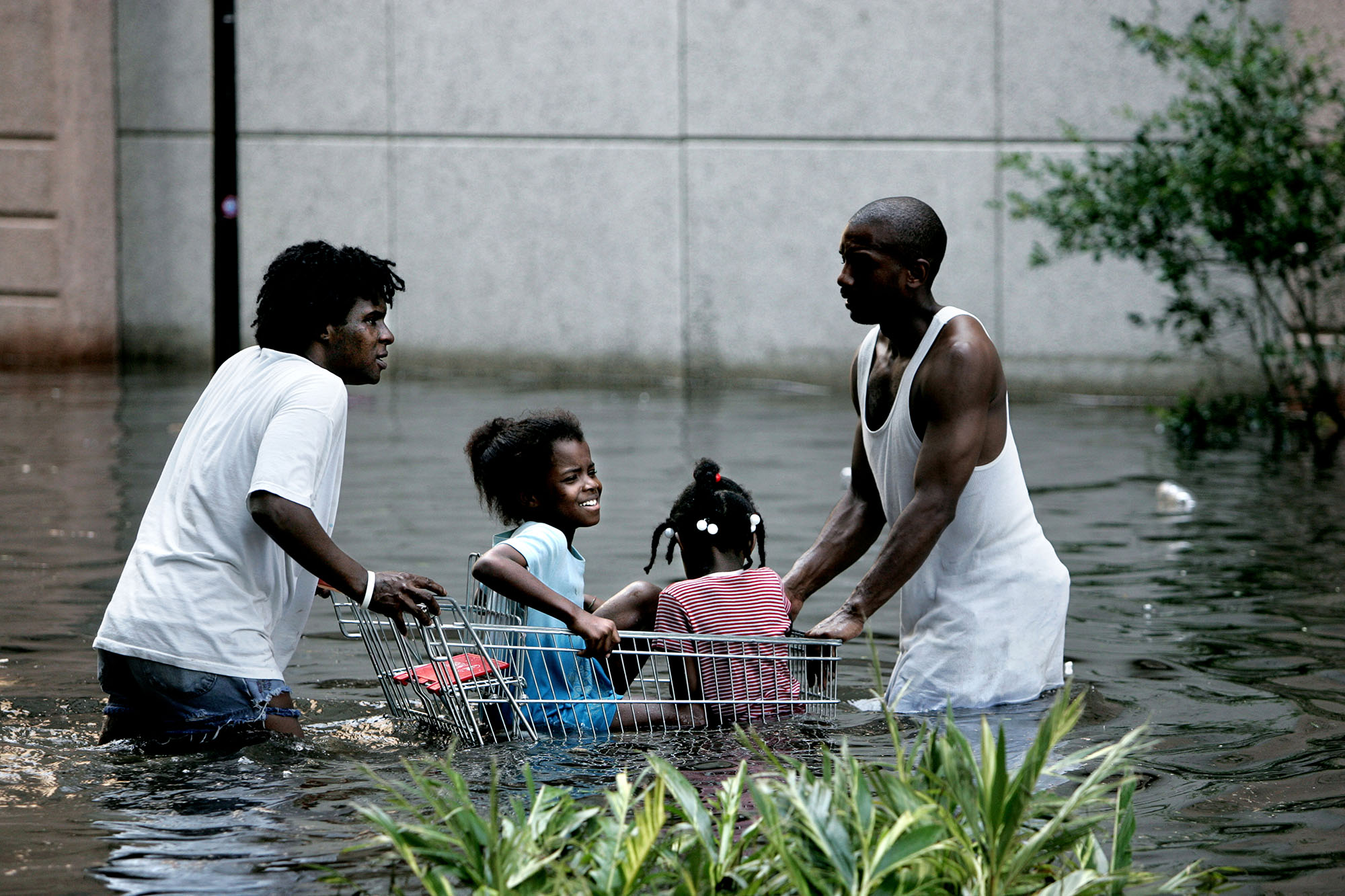 Hurricane Katrina has flooded 80% of New Orleans and this family are trying to reach the Superdome where many people had gathered to wait for help.