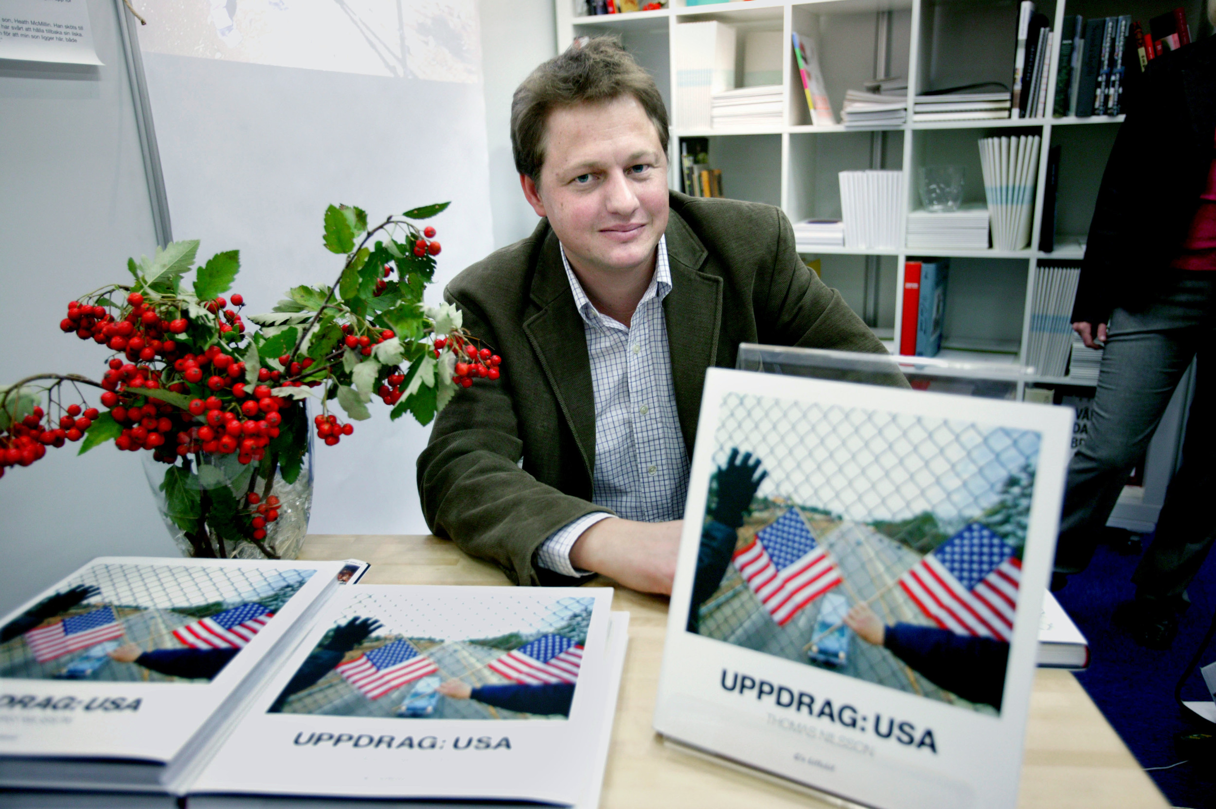 Photographer Thomas Nilsson at the Gothenburg Book Fair in September 2004 with his photo book Uppdrag: USA (Assignment: USA), published the same month by C/o Lillebil. ISBN: 91-975078-0-6.  Read more here.