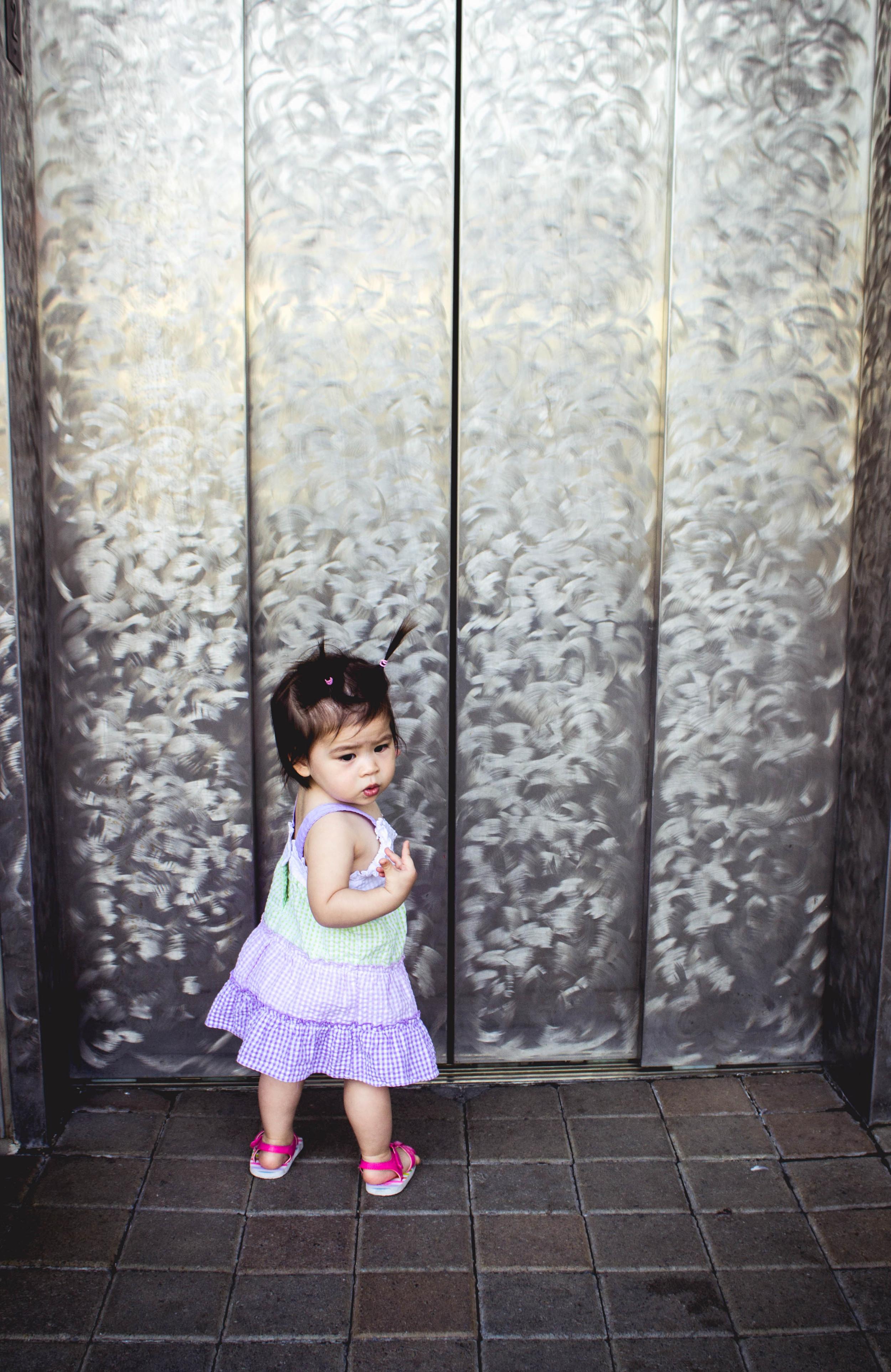 Selah posing in front of elevator.jpg
