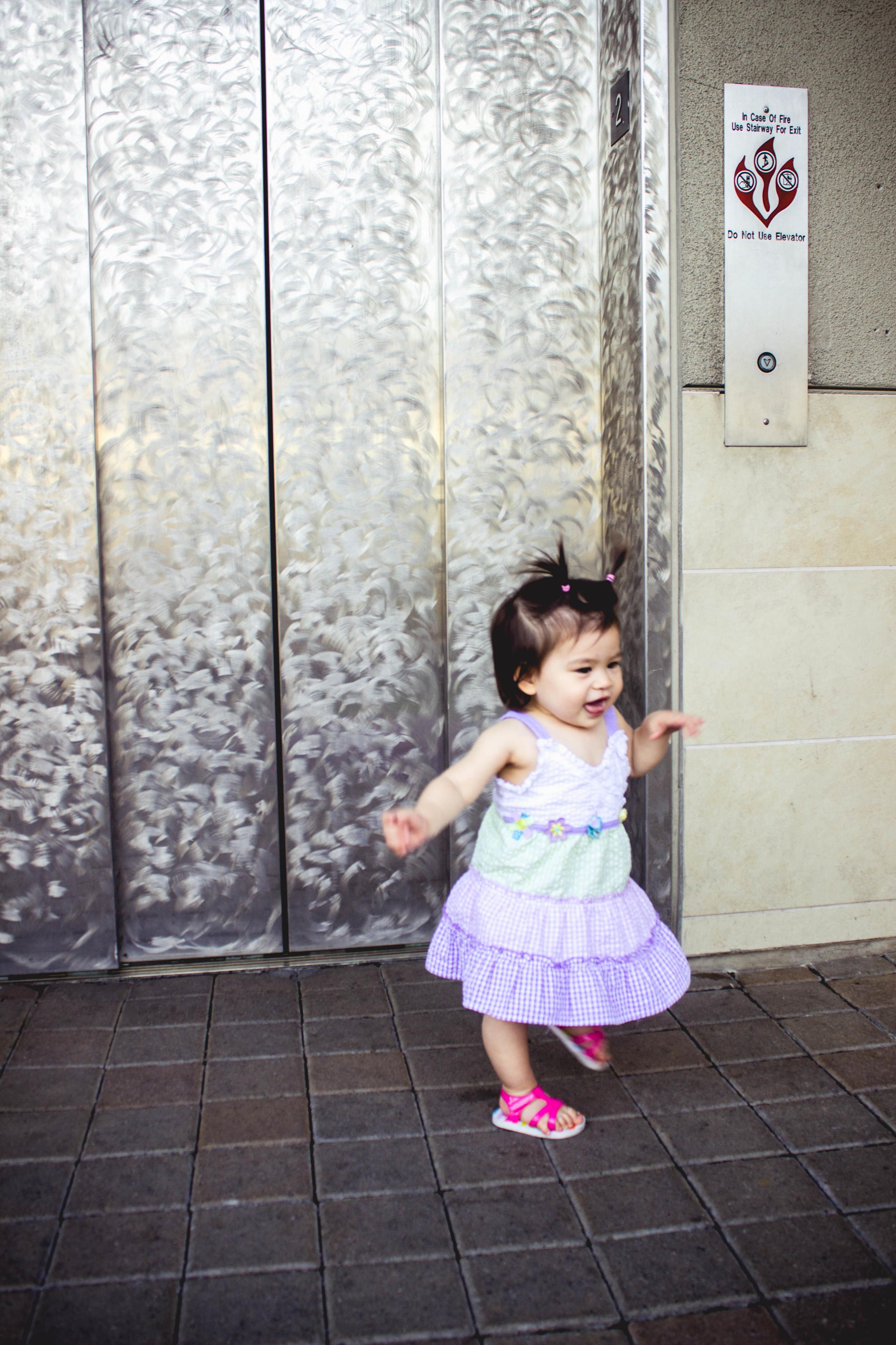 Selah running by elevator.jpg