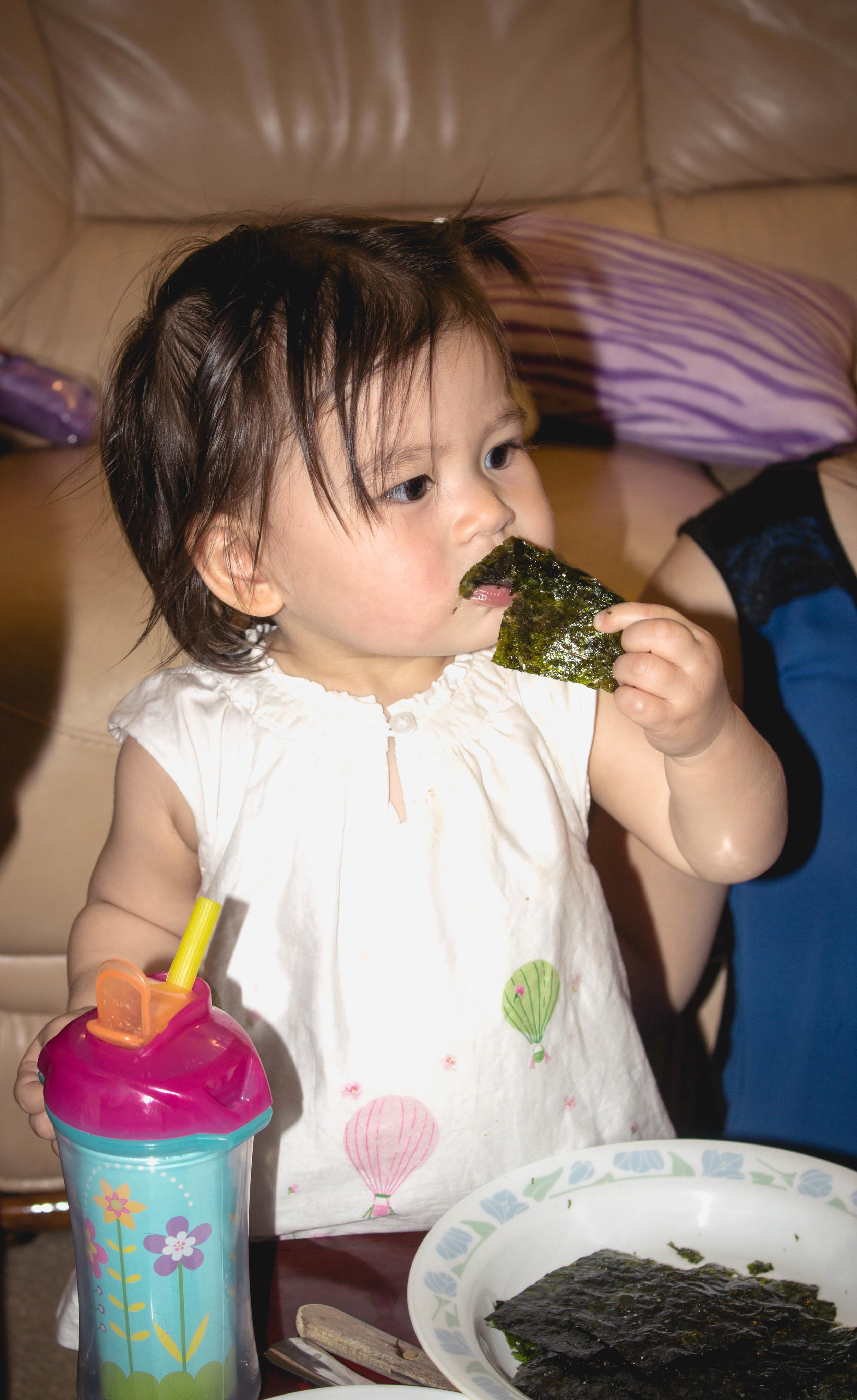 Selah eating kim or nori sheets.jpg