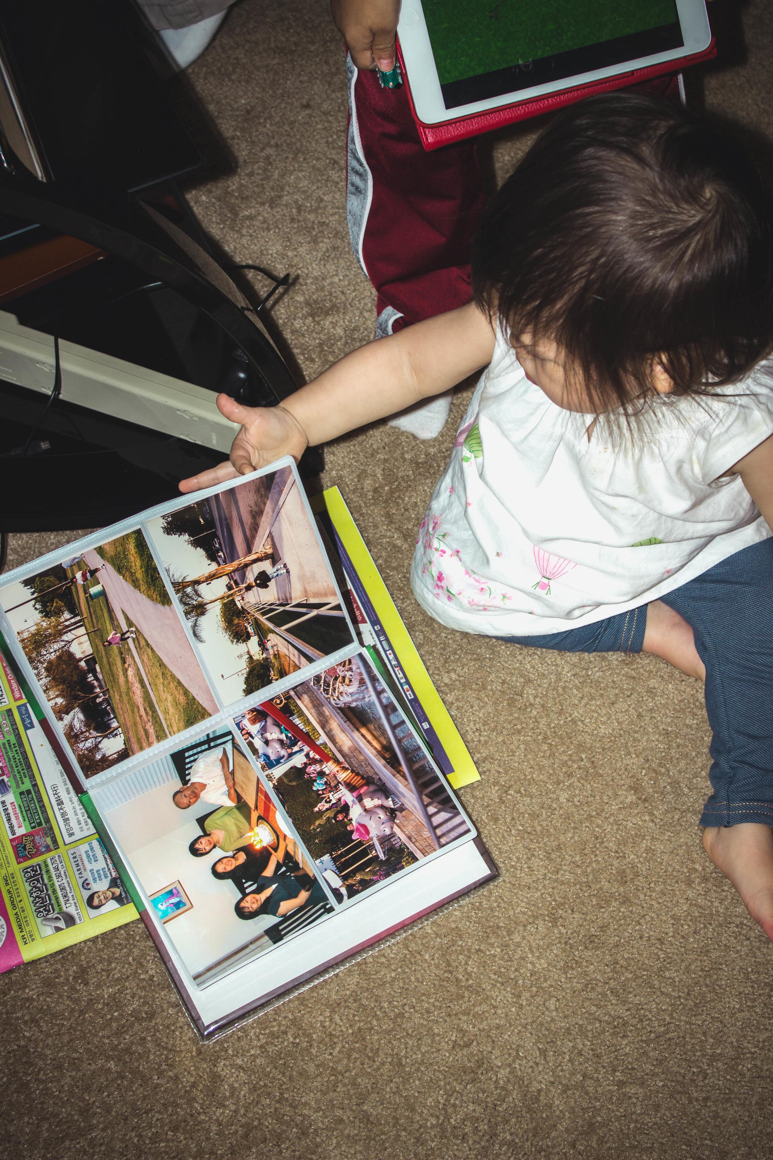 Selah going through albums.jpg