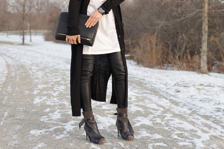 WoahStyle.com | Isabel Marant Angie boots, leather leggings, white tunic and long black cardigan from Zara, Alexander Wang Fumo clutch and Fjord Munnan watch. #streetstyle #blackandwhitestyle
