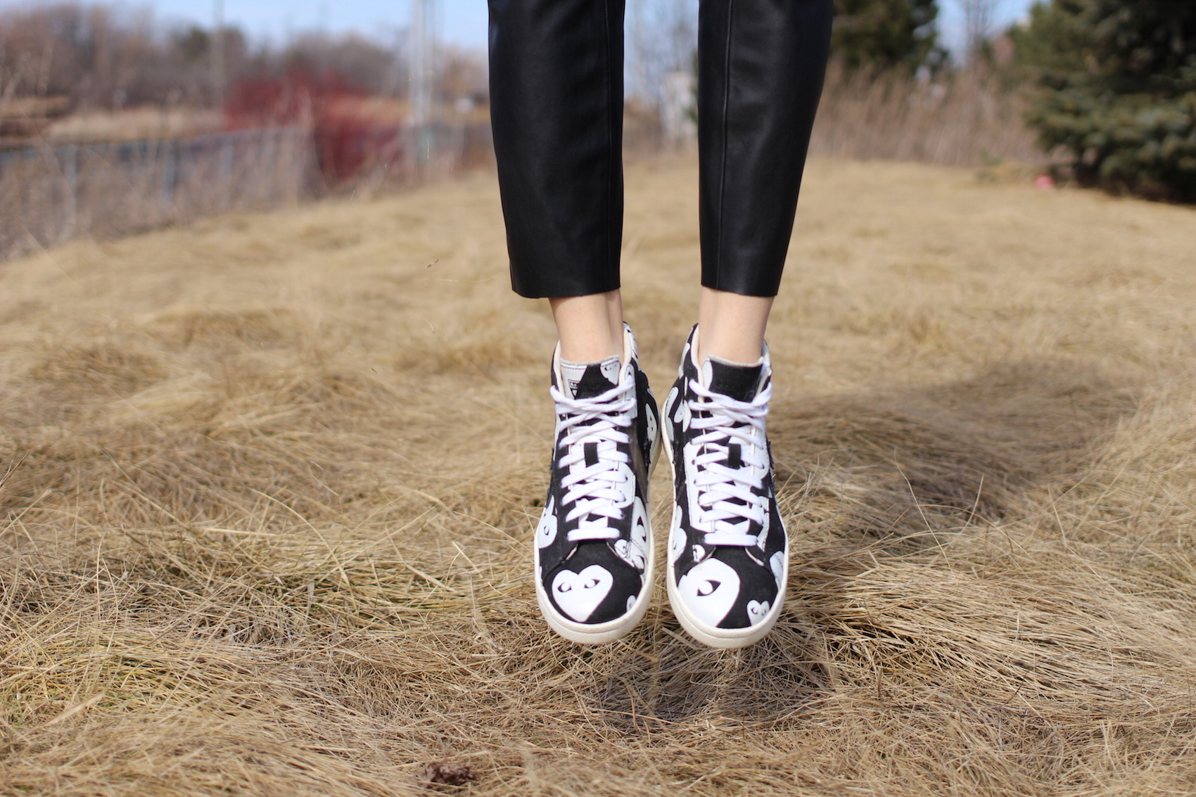 WoahStyle.com | Black and white Comme Des Garcons PLAY heart converse sneakers. Street style.